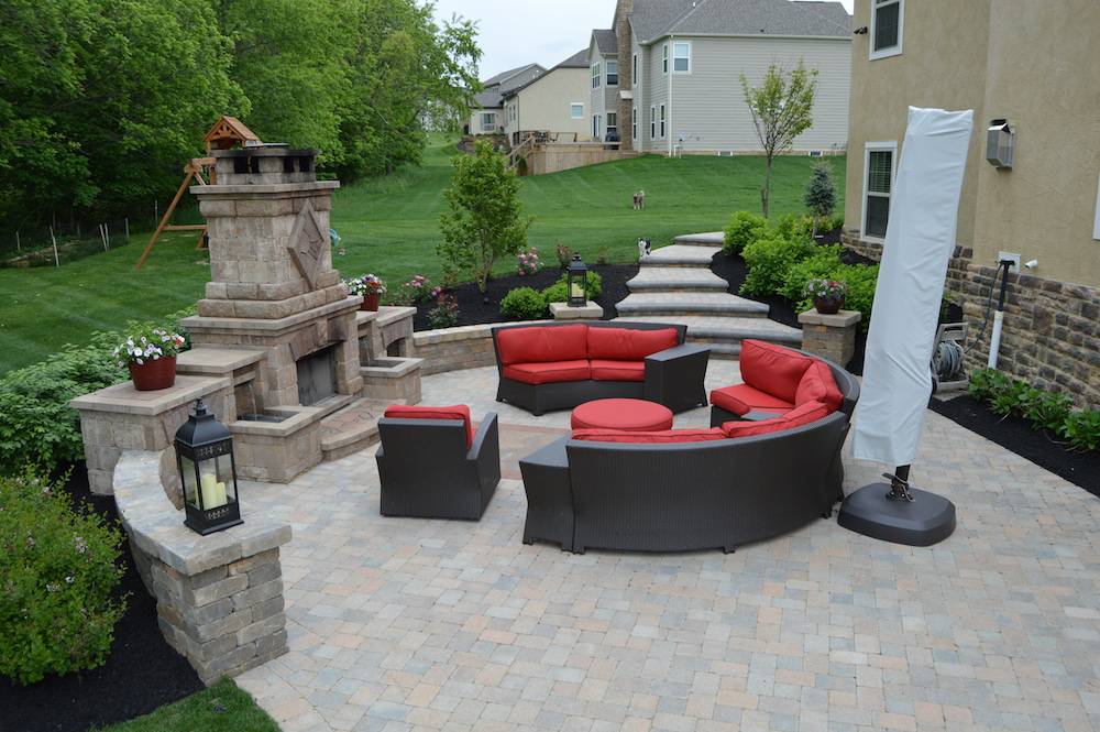 Outdoor Living Space With Fireplace At Olentangy Falls In Delaware
